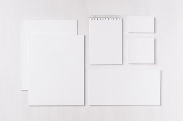 Corporate identity template with black white paper stationery set on soft white elegans wood board. Mock up for branding, business presentations and portfolios.