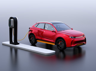 Red electric SUV car charging in charging station. 3D rendering image.