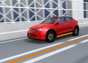Metallic red autonomous electric SUV driving on the highway. 3D rendering image.