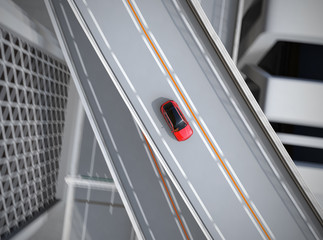 Aerial view of metallic red electric SUV driving on the highway. 3D rendering image.