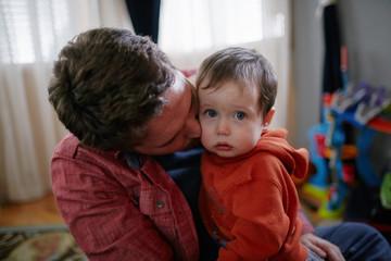 father comforting sad child