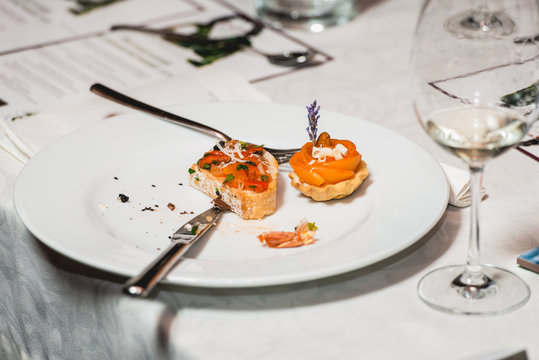 Served table for food and wine tasting. Snacks with shrimp, fish fillets, Spain tapas recipe food pintxos