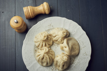 Georgian dumplings Khinkali with meat on white plate with copy space