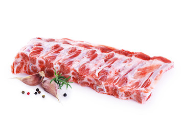 Raw fresh pork ribs, garlic, pepper and rosemary isolated on white background.