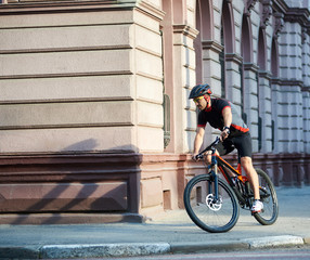 Bicyclist in professional cycling clothing and protective helmet ... 4df28211b