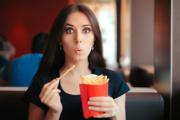 Funny Girl Eating Fries in French Fast Food Restaurant