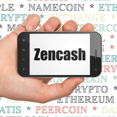 Blockchain concept: Hand Holding Smartphone with  black text Zencash on display,  Tag Cloud background, 3D rendering