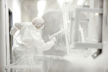 Industrial metal finishing powder coating: mixture of finely ground particles of white pigment and resin, which is electrostatically charged and spraying on to products