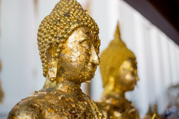 Tradditional Thai face of Buddha for Buddhism at Temple in Thailand. Golden Buddha is believed and faith of Religious