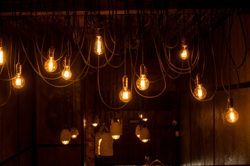 Vintage tungsten lamps in stylish loft interior