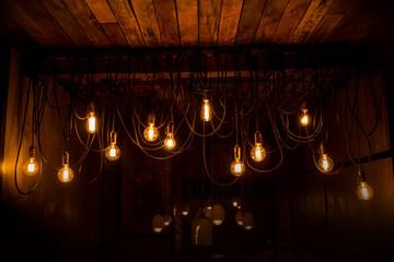 Vintage tungsten lamps in stylish loft interior
