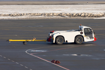 Tow truck for airplanes at the airfield.