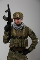 Picture soldier in goggles with gun in his hand