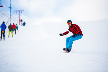 Photo of athlete with snowboard jumping on snowy hill