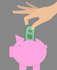Woman's hand putting money bill in pink piggy bank. Savings concept