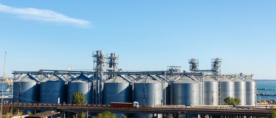 Modern grain elevator towers in Odessa port.