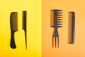 Four black combs on yellow and orange background.