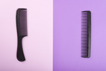 Two combs on pink and purple background.