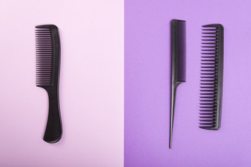 Three combs on pink and purple background.