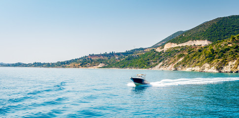 Motorboat driving on Ionian sea near Zakynthos island, Greece