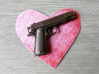 Pistol and heart life and death force of arms not of freedom power over the destinies of people