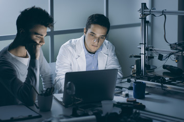 Engineering students in the lab at night