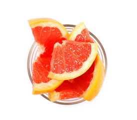 Grapefruit slices in glass bowl isolated on white background, top view
