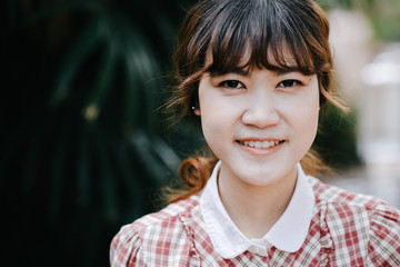 Asian Girl young teen hipster closeup head happy smile vintage color tone