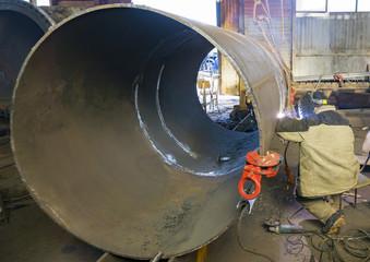 Manual arc welding. Heat exchanger welding.