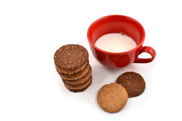 Red mug with milk and biscuits stock images. Cup of milk on a white background. Red mug of milk with cookies