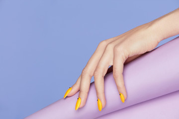 Nails Design. Hands With Bright Yellow Manicure