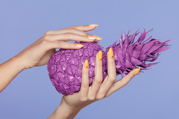 Nails Manicure. Hand With Stylish Nails Holding Purple Pineapple