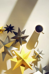 Cup of coffee with handmade paper stars