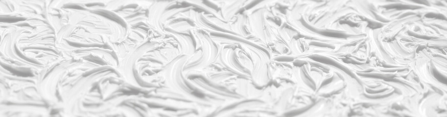 A beautiful white background is painted with paint with the help of brushes. Texture surface with patterns and strokes, pattern for wallpaper.