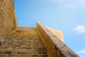 Victoria, Gozo. Ancient walls of Citadel built of limestone with long stairway