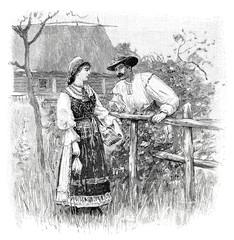 Junges Paar unterhält sich auf einer Wiese - 197485738
