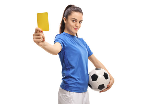 Female soccer player showing a yellow card