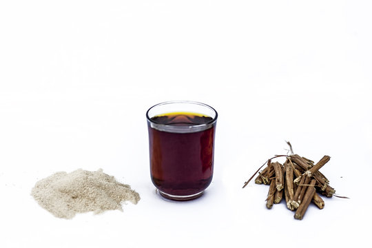 Ashwagandha roots and its powder also known as Indian ginseng, isolated on white essential beneficial for hair loss with its organic extract made from its powder.