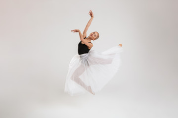 Pretty young woman ballerina dancing gracefully