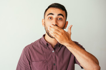Excited Young Attractive Man Covering Mouth
