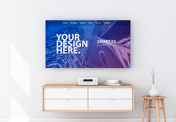 Flatscreen TV on White Wall Over Drawers Mockup
