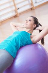 Attractive woman exercising with fitness ball