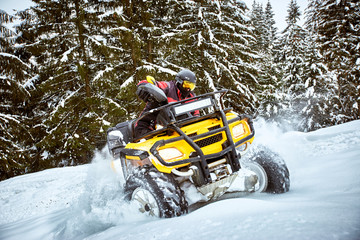 Winter race on an ATV on snow in the forest.
