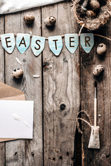 "Blue chicken easter eggs and the same text ""Happy Easter"" on rustic wooden background with copy space. top view"