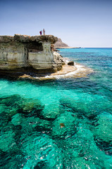 Sea caves of Cavo greco cape. Ayia napa, Cyprus with men