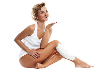 Woman shaves her leg on white background