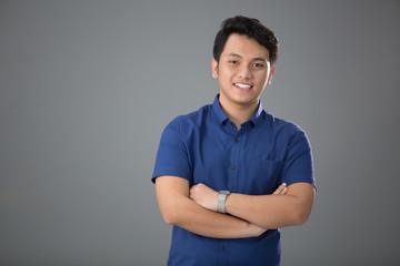 Fototapeta Asian Young Casual Man Smiling