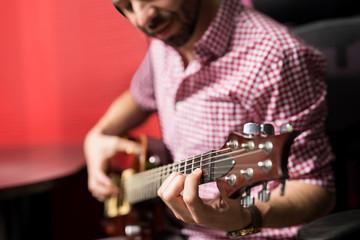 Guitarist playing guitar at radio station