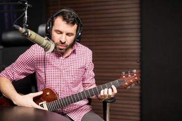Artist singing live in live radio show