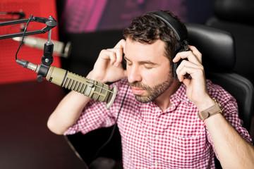 Latin male radio host in studio